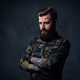 Portrait of bearded tattooed hipster male dressed in a military jacket. - PhotoDune Item for Sale