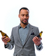An elegant black American male dressed in a suit holds a craft beer bottle. - PhotoDune Item for Sale