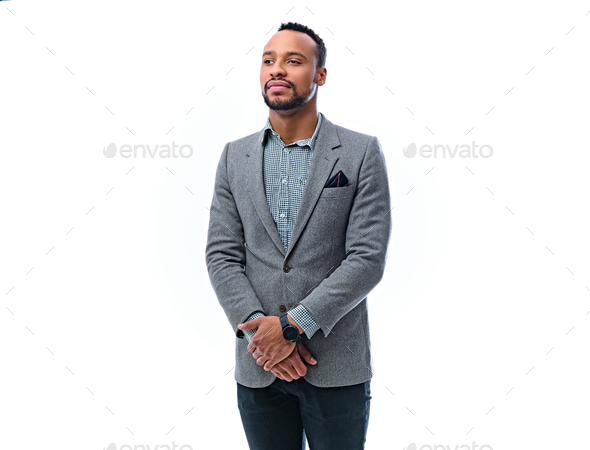An elegant black male dressed in a suit isolated on white background. - Stock Photo - Images