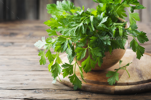 Green fresh parsley on the wooden table - Stock Photo - Images
