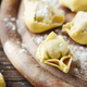 homemade Italian traditional tortellini on the wooden table - PhotoDune Item for Sale
