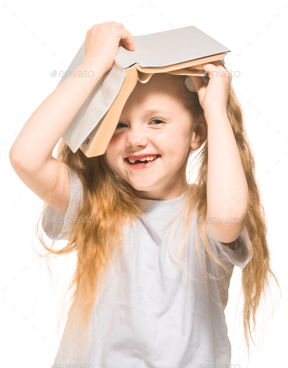 Little girl with red hair with a book on a white isolated background - Stock Photo - Images