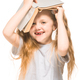Little girl with red hair with a book on a white isolated background - PhotoDune Item for Sale