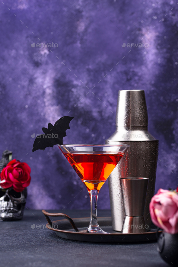 Halloween martini cocktail on purple background - Stock Photo - Images