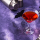 Halloween martini cocktail on purple background - PhotoDune Item for Sale