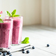 Two Glasses of Blueberry Smoothie with Mint Garnish. - PhotoDune Item for Sale