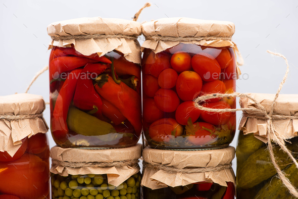Homemade Delicious Pickles in Jars Isolated on Grey - Stock Photo - Images