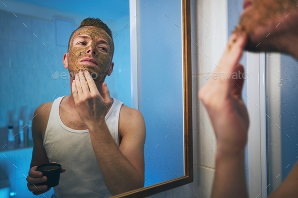 Man applying facial mask - Stock Photo - Images