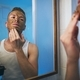 Man applying facial mask - PhotoDune Item for Sale