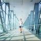 Young man walking on bridge - PhotoDune Item for Sale