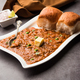 Pav bhaji is a popular Indian street food that consists of a spicy mix vegetable mash & soft buns - PhotoDune Item for Sale
