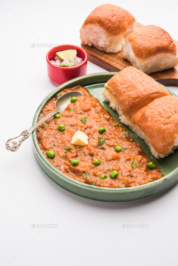 Pav bhaji is a popular Indian street food that consists of a spicy mix vegetable mash & soft buns - Stock Photo - Images