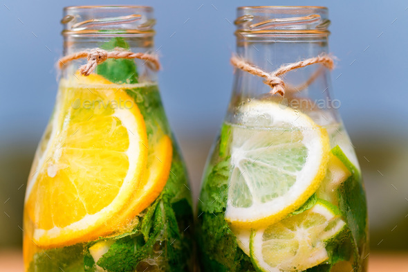 Homemade lemonade with fruit and mint. Closeup - Stock Photo - Images