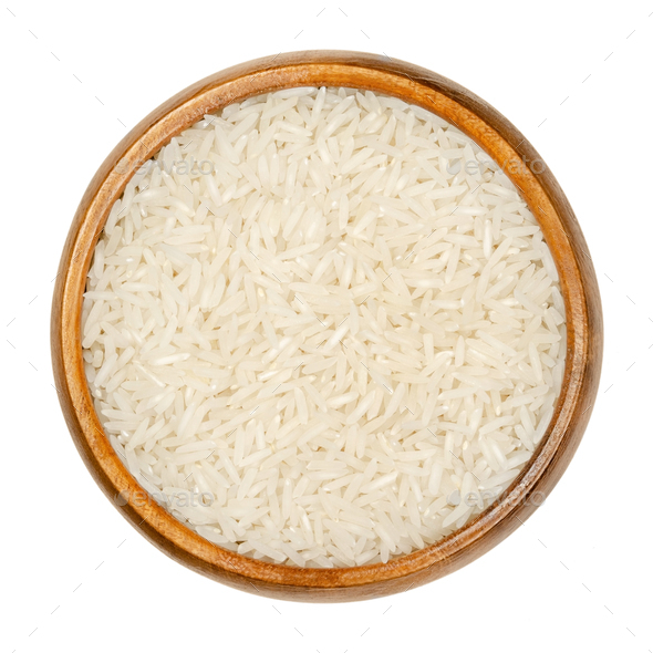 White Basmati rice, aromatic long grain rice in wooden bowl - Stock Photo - Images