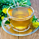Herbal tea in a cup with a bouquet of Rhodiola rosea on the board - PhotoDune Item for Sale