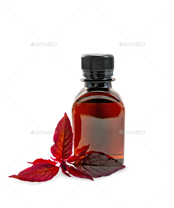 Oil with amaranth in dark bottle - Stock Photo - Images