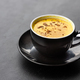 Serving of aromatic turmeric black coffee against dark table - PhotoDune Item for Sale