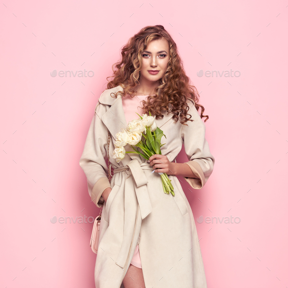 Young woman in white spring coat - Stock Photo - Images