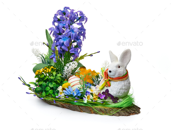 Easter installation from a flower arrangement and a rabbit on a white background - Stock Photo - Images