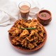 Crispy Onion Fritters or pakora known as Pyaj Pakoda or Kanda bhaji / Bhajji / bajji - PhotoDune Item for Sale