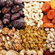 Flat lay view at assorted dried fruits and nuts in wooden crate. Healthy vegetarian food concept - PhotoDune Item for Sale