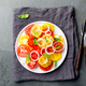 Red and yellow fresh tomato salad with onion, basil and olive oil on white plate. - PhotoDune Item for Sale