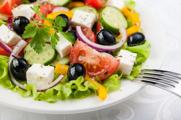 Greek salad on the white plate - Stock Photo - Images