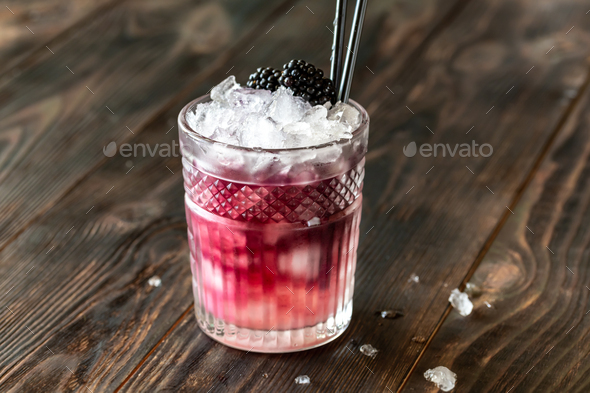 Glass of Bramble cocktail - Stock Photo - Images