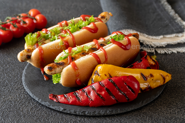 Two hot dogs on stone board - Stock Photo - Images