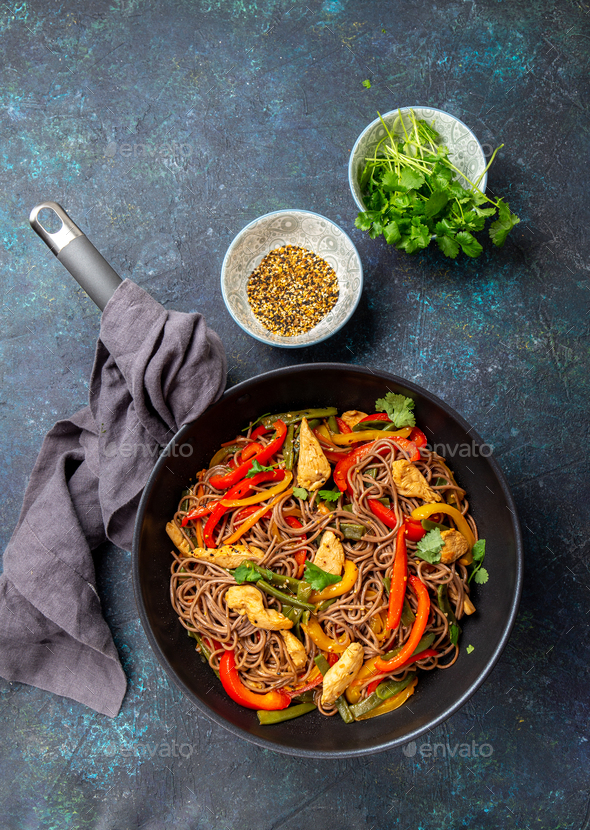 Japanese dish buckwheat soba noodles with chicken and vegetables carrot, bell pepper and green beans - Stock Photo - Images