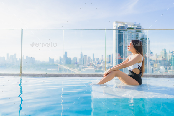 Portrait beautiful young asian woman relax leisure around swimming pool - Stock Photo - Images