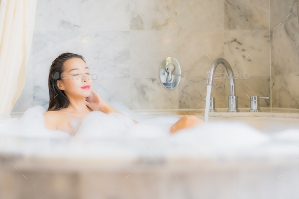 Portrait beautiful young asian woman relax take a bath - Stock Photo - Images