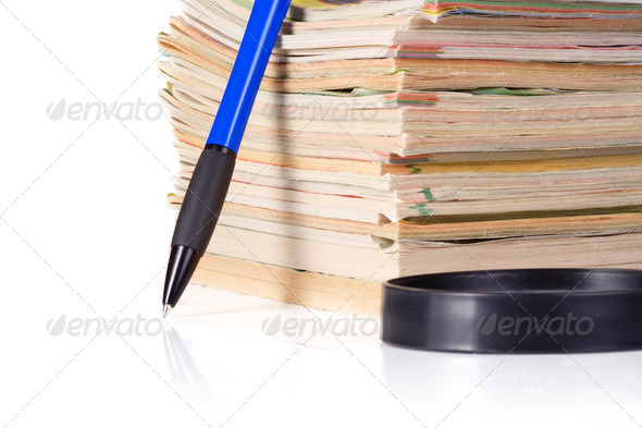 magazine, magnifying glass and pen - Stock Photo - Images