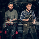 Two bearded tattooed mechanics near the car in a workshop. - PhotoDune Item for Sale