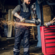 Mechanic cuts steel car part with an angle grinder. - PhotoDune Item for Sale
