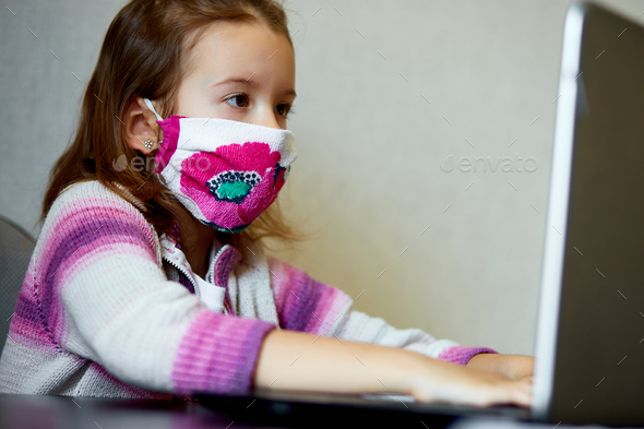 Schoolgirl studying at home with a notebook and doing school homework. - Stock Photo - Images