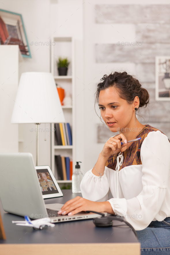 Female entrepreneur looking at laptop - Stock Photo - Images