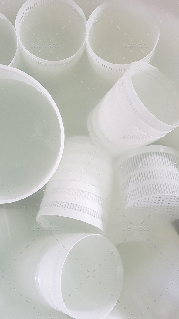 Plastic forms for ricotta cheese making - Stock Photo - Images