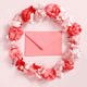 Red envelope in a frame of pink flowers over a pink background - PhotoDune Item for Sale