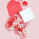 Red envelope and gift box full of flowers  over a pink background - PhotoDune Item for Sale