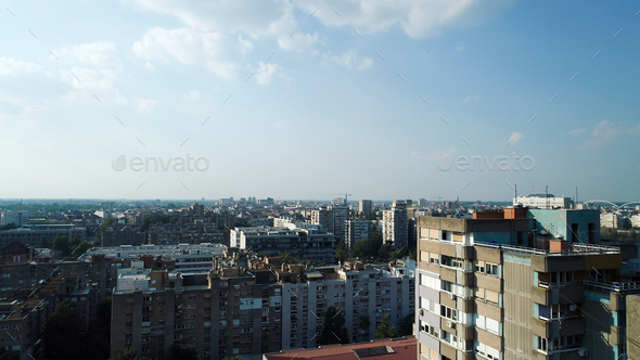 Crowded cityscape with buildings, apartment in background - Stock Photo - Images