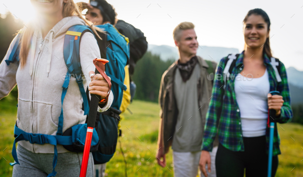Trekking, hiking, camping and wild life concept. Group of friends walking together in nature - Stock Photo - Images