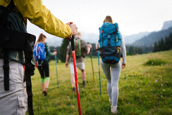Group of happy fit friends hiking, trekking together outdoor nature - Stock Photo - Images