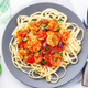 Linguine Puttanesca pasta with shrimps in spicy tomato basil sauce horizontal, top view - PhotoDune Item for Sale