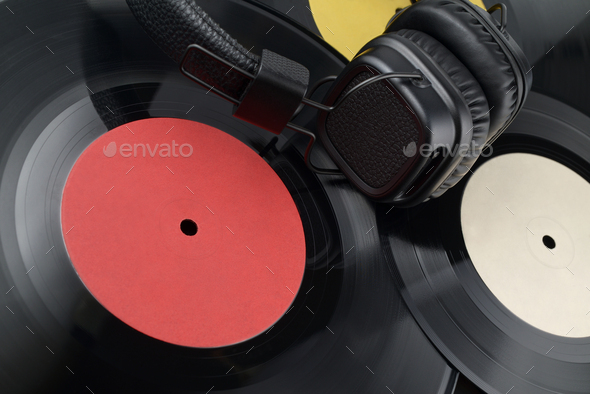 Headphones on the heap of different vinyl records. - Stock Photo - Images