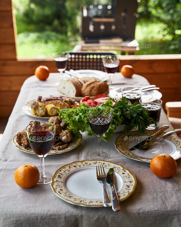 Holiday table full of food grill on background - Stock Photo - Images
