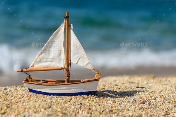 Miniature fishing boat at beach - Stock Photo - Images