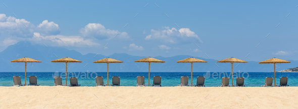 Beach chairs with umbrella with blue sky - Stock Photo - Images