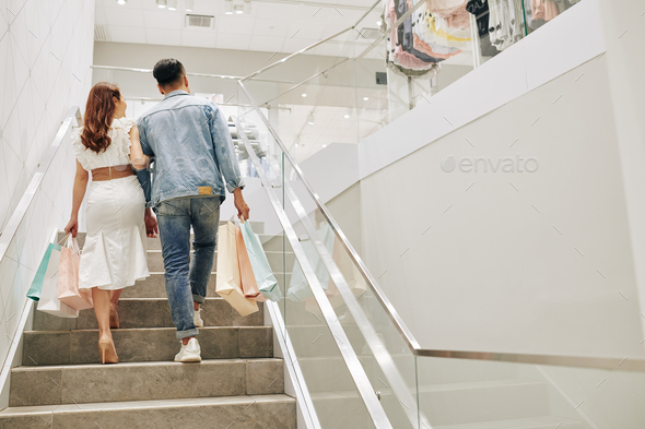 Couple walking up the stairs - Stock Photo - Images