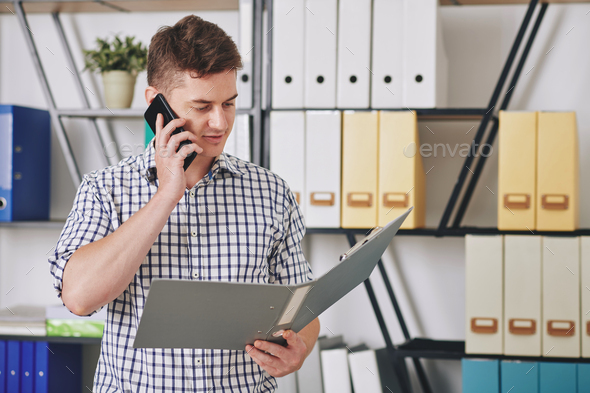 Businessman reading report - Stock Photo - Images